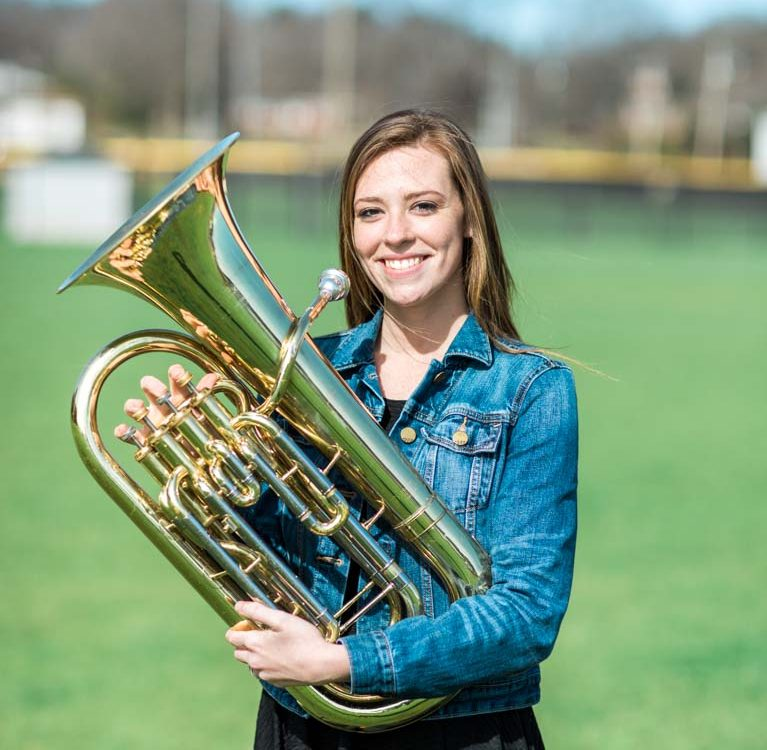 Portrait of Oxford High School student Abby McDow holding her instrument